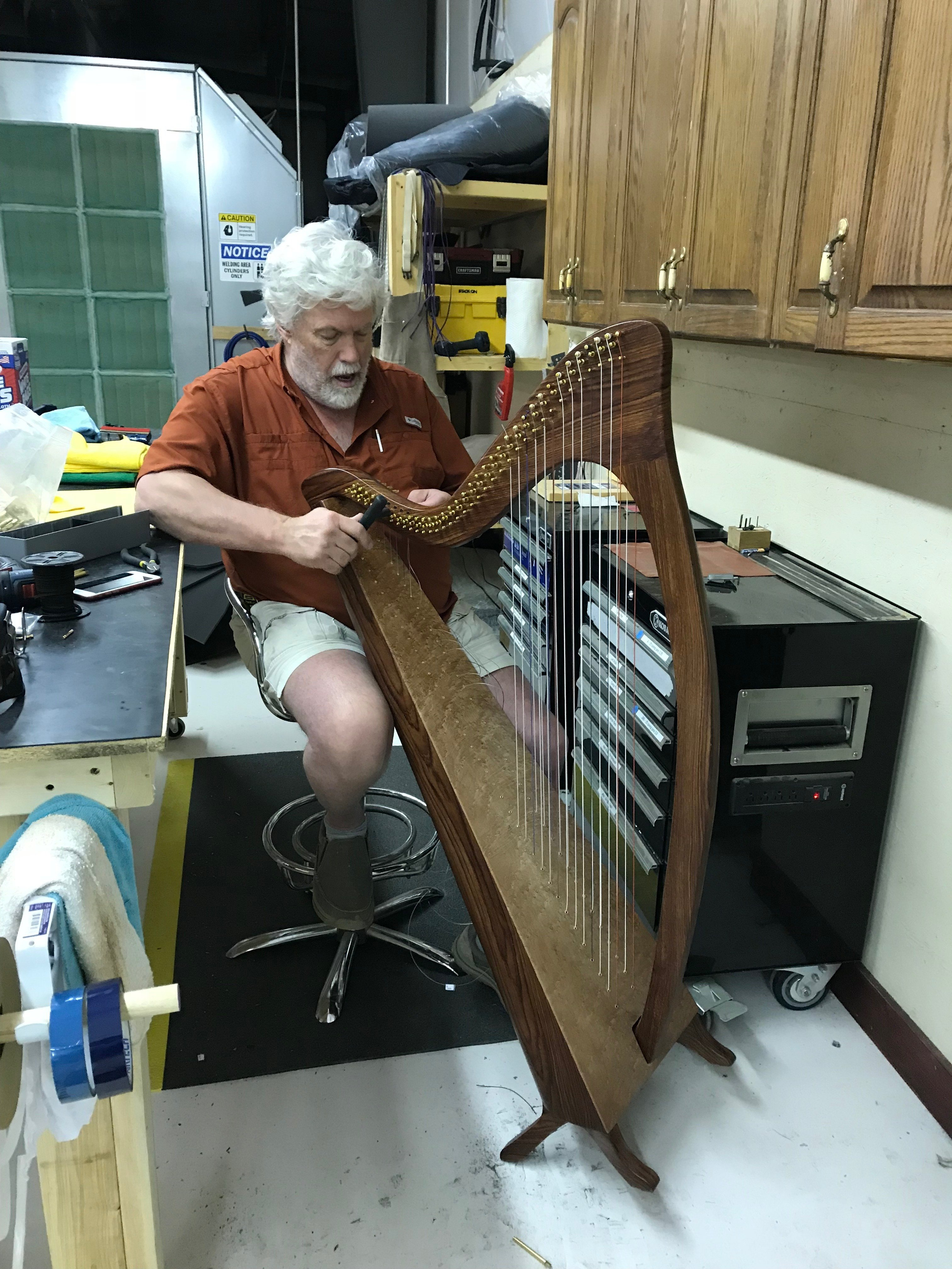 Carbon fiber harp with wood grain finish