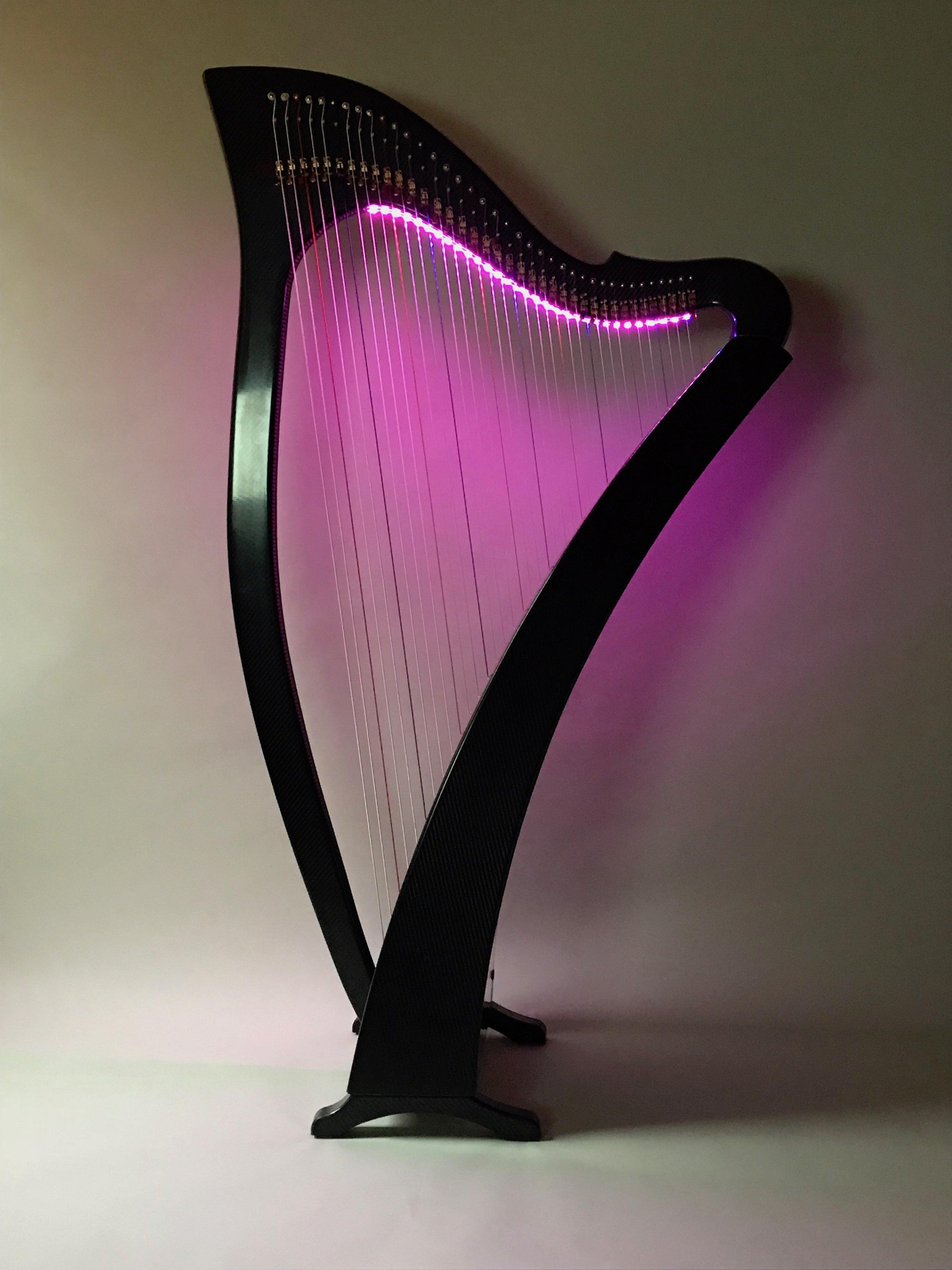 Carbon fiber 38-String Delight lever harp with pink LED lights