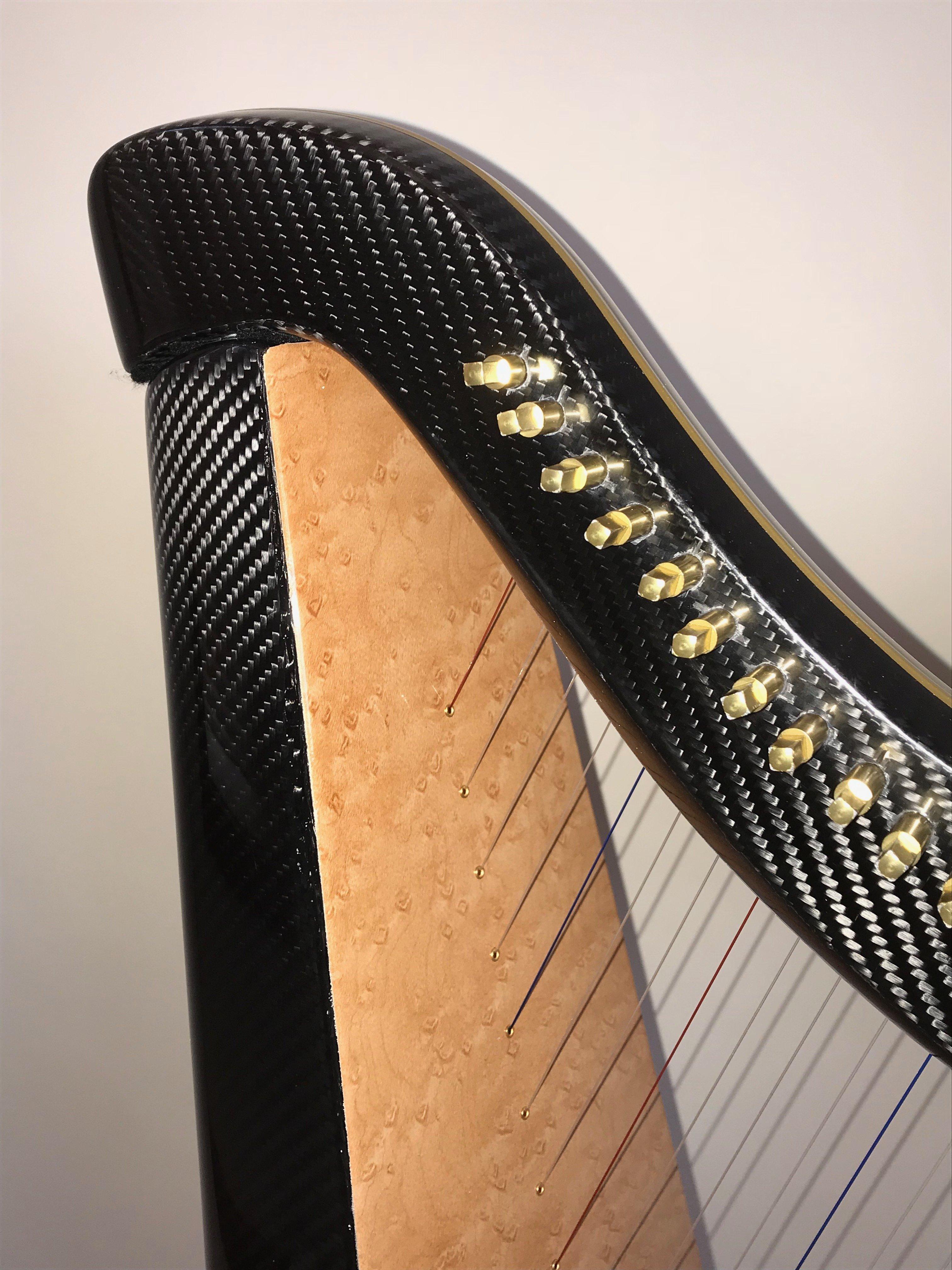 wood grain finish on carbon fiber harp
