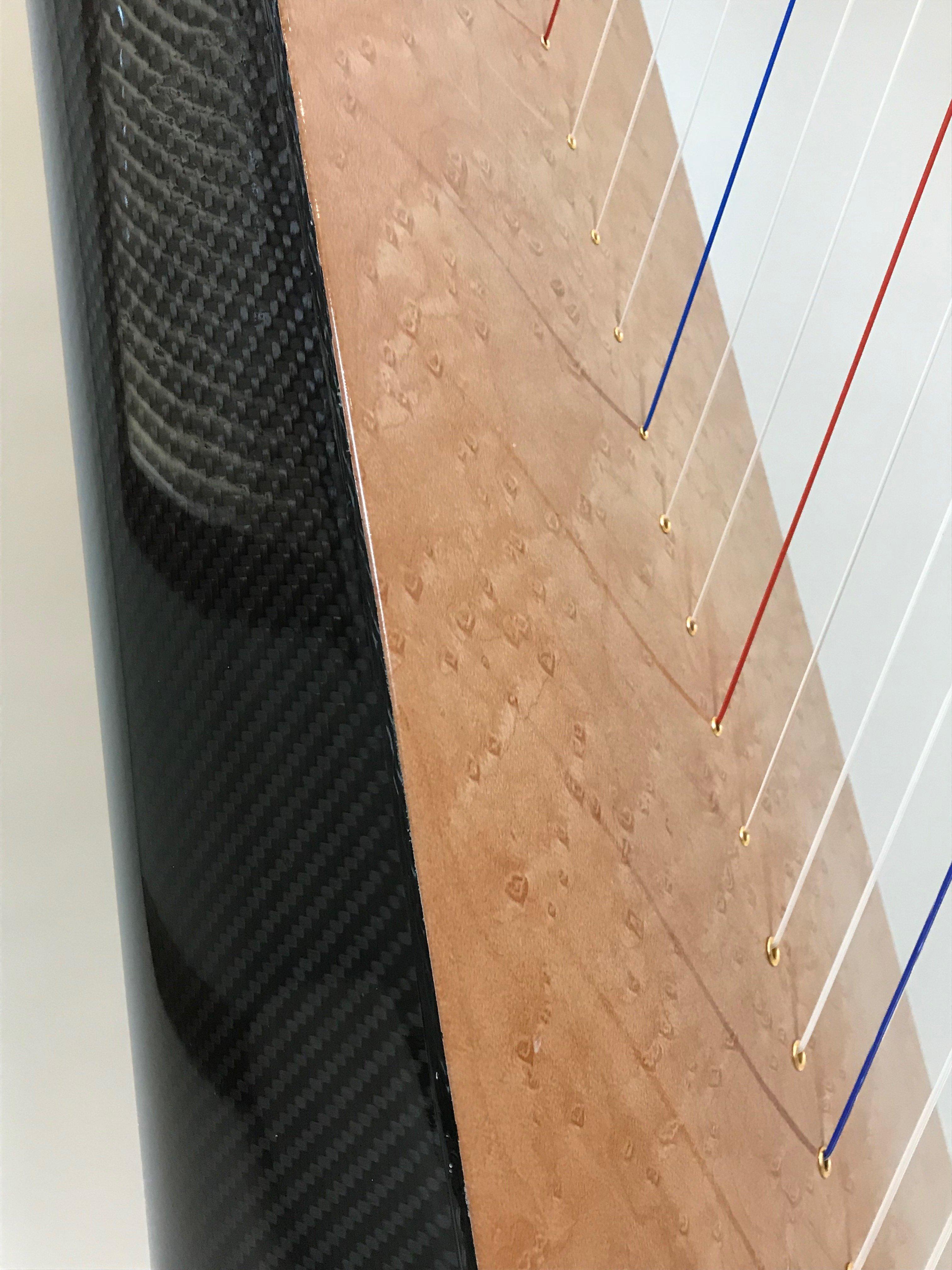 wood grain on carbon fiber harp
