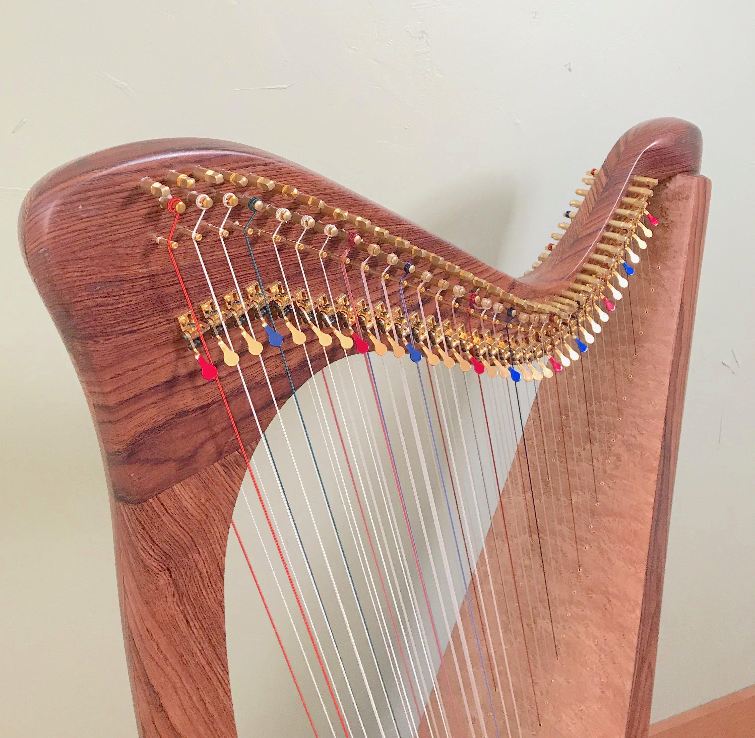 carbon fiber harp with wood grain finish