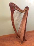 carbon fiber harp, wood grain finish, double strung harp