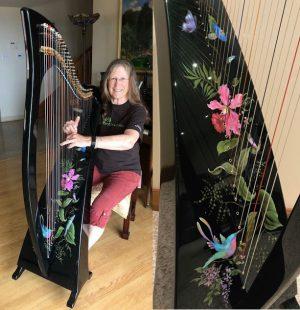 Carol Ecklund with her Hummingbird Delight harp.