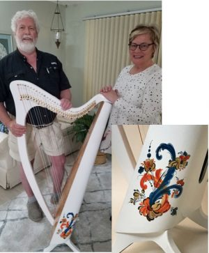 Dave Woodworth and Laura Haugen with her Rosemaling Legend harp.